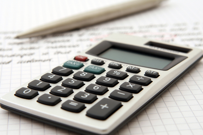 Calculator and pen indicating work/study